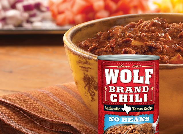 Wolf Brand Chili review: I am boycotting Con-Agra since they own Wolf brand chili. I bought 6 cans of chili (no beans) to make chili dogs for our 4 children, nieces, Wolf Brand Chili - Never buying this brand again.